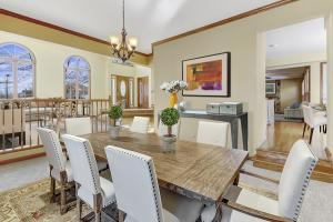 Carpeted dining area, staged